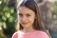 Portrait of smiling girl in the garden - SARF04232