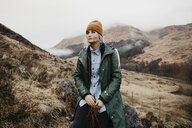 UK, Scotland, Highland, pensive young woman in rural landscape - LHPF00596