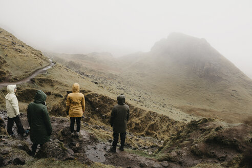 UK, Scotland, Isle of Skye, Quiraing Viewpoint, rear view of four women in foggy landscape - LHPF00623