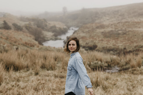 UK, Scotland, Isle of Skye, portrait of young woman in rural landscape - LHPF00626