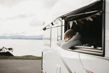 UK, Scotland, Highland, young woman at the window of a camper van - LHPF00650
