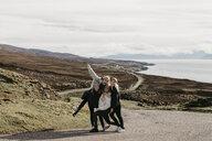 UK, Scotland, Highland, happy female friends on a road at the coast - LHPF00653