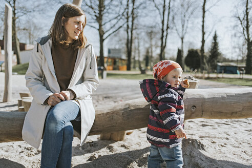 Mother with little daughter on a playground - DWF00417