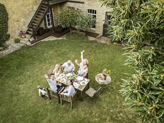 Family eating together in the garden in summer - PESF01559