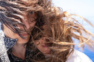 Seychelles, Indian Ocean, mature couple with windswept hair, close-up - NDF00904