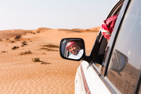 Bedouin looking in his car mirror, Sultanate Of Oman, Wahiba Sands - WVF01305
