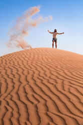 Sultanate Of Oman, Wahiba Sands, Mid adult man is playing with sand in the desert - WVF01350