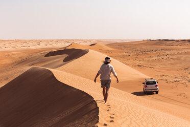 Man walking on a sand dune, Wahiba Sands, Oman - WVF01353