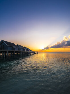 Maledives, Ross Atoll, water bungalows at sunset - AMF06908