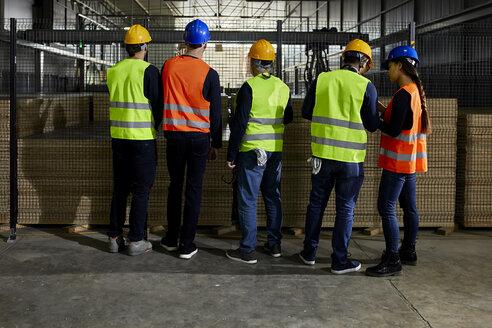 Rear view of workers standing in factory workshop - ZEDF02078