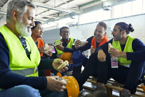 Happy workers in factory having lunch break together - ZEDF02132