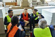Workers in factory having lunch break together - ZEDF02138