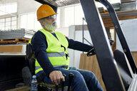 Worker on forklift in factory - ZEDF02165