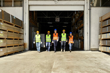 Group of workers walking on factory yard - ZEDF02207