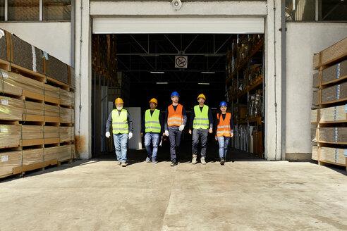 Group of workers walking on factory yard - ZEDF02207