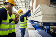 Workers talking in factory warehouse - ZEDF02228