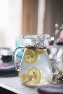 Glass jug of water flavoured with lemon - ALBF00860