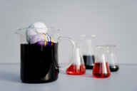 Eggs dyed with rubber bands and purple natural colour in measuring flask - GISF00413