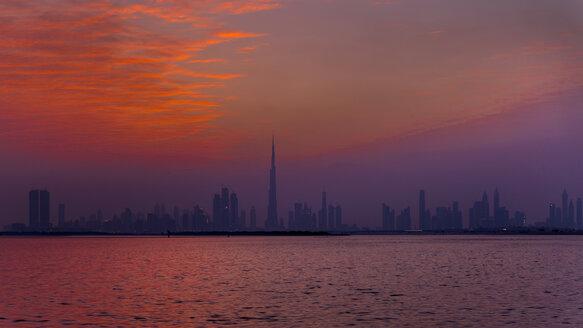 United Arab Emirates, Dubai, silhouette of the skyline at twilight - HSIF00506
