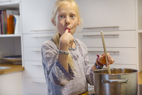 Portrait of girl cooking jam at home - HSIF00524