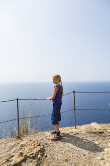 Italy, Liguria, Portofino, girl at the coast looking at view - HSIF00530