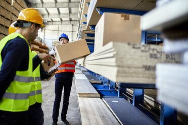 Men working in factory warehouse - ZEDF02261