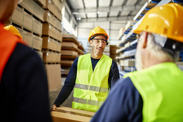 Workers talking in factory warehouse - ZEDF02273
