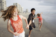Friends playing on beach - BLEF00086