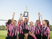 Cheering girl soccer players posing with trophy - BLEF00104