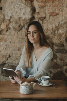 Spain, Aragon, Zaragoza, portrait of a woman with a tablet in a coffee shop - AHSF00152
