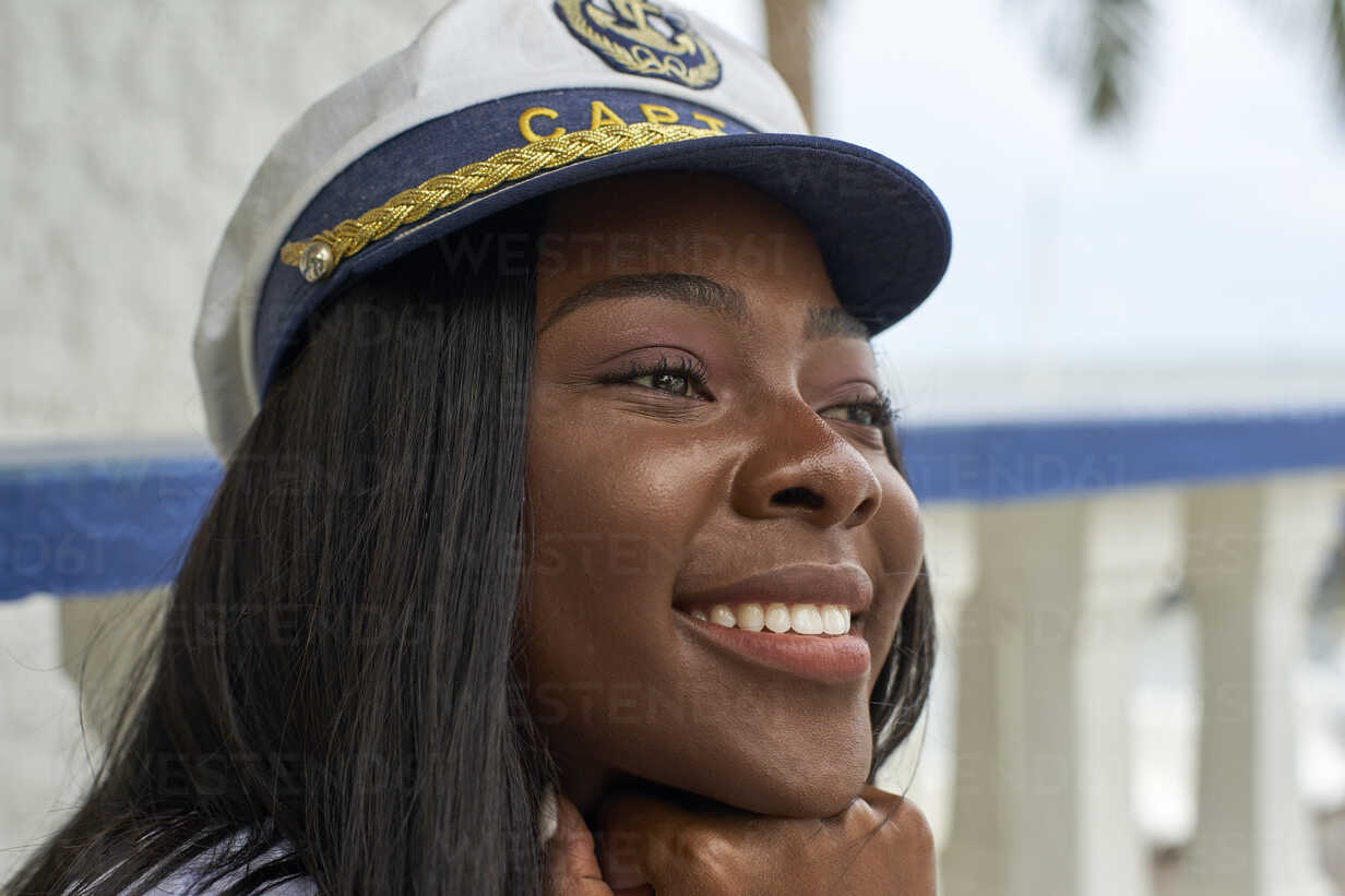 Portrait of happy young woman wearing Captain's hat - VEGF00086 - Veam/Westend61