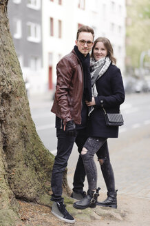 Portrait of stylish young couple in the city - EYAF00164
