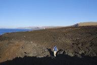 Spain, Canary Islands, Lanzarote, Tinajo, Los Volcanos nature park, women hiking through lava waste - SIEF08597