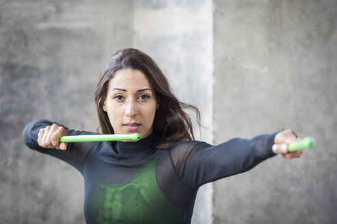 Portrait of young woman doing pound fitness exercise - ASCF00980