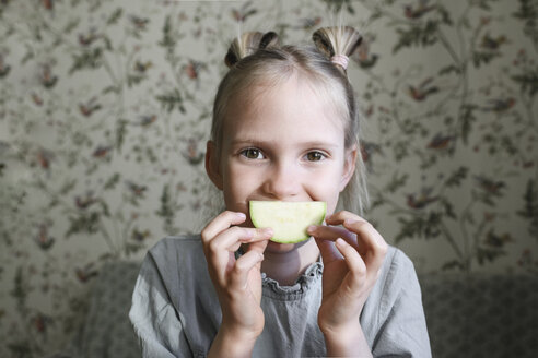 Portrait of blond girl with slice of courgette - EYAF00176