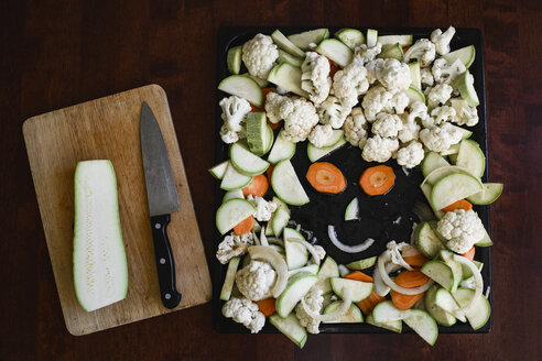 Russia, Moscow, black pan with sliced vegetables and smiling face making from vegetables - EYAF00179