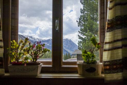 Italy, Trentino Alto-Adige, Moena, view through the window - FLMF00176