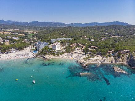 Spain, Majorca, Costa de la Calma, aerial view over Peguera with hotels and beaches - AMF06936