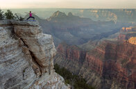 Caucasian woman practicing yoga on cliff near canyon - BLEF00165