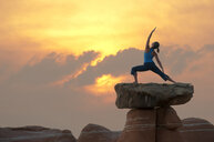 Caucasian woman practicing yoga on top of rock formation - BLEF00168