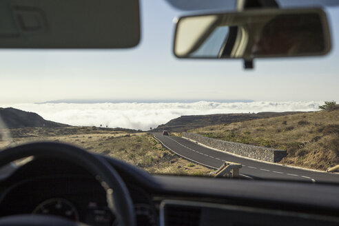 Spain, Canary Islands, La Gomera, view out of a windscreen to a cloud cover over the Atlantic - MAMF00629
