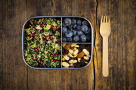 Lunchbox with bulgur herbs salad with pomegranate seeds, taboule, blueberries and trail mIx - LVF07974