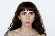 Portrait of tattooed young woman with freckles - FLLF00123