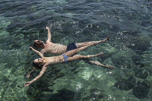 Indonesia, Komodo National Park, father and daughter floating in the sea - MCF00143