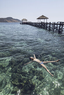 Indonesia, Komodo National Park, girl floating in the sea - MCF00146