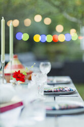 Placesettings on dinner garden party table - CAIF23231