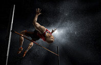 Male track and field athlete high jumping - CAIF23285