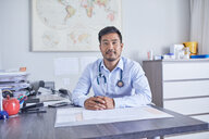 Portrait confident male doctor working in clinic doctors office - CAIF23367