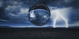 Sphere floating in remote landscape - BLEF00343