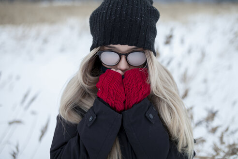 Cold Asian girl wearing a hat and eyeglasses in winter - BLEF00448